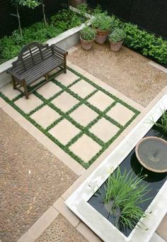 special viewing area of water feature is marked with a stone and greenery rug