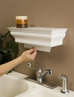 Cleaver way to hide paper towel holder.  Use shelf to display cookbooks.