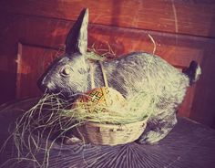 cast iron rabbit with wire baskets and vintage wooden eggs. One of my favorites!