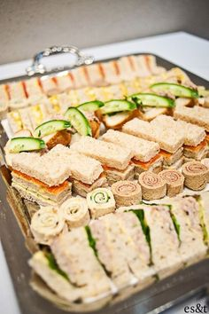 A big tick from me ~ tea sandwiches- how to display- make each table a nice tray like this! Much more appealing, we eat with our eyes first. ~ Enjoy!