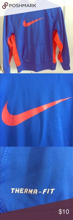 Nike Hoodie Blue Nike therma-fit hoodie with orange Nike check and orange details. In great condition! Nike Shirts & Tops Sweatshirts & Hoodies