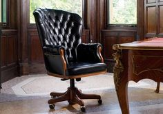 Berto Salotti's President executive armchair, with poplar and beech wood frame and brass wheels. Yes!