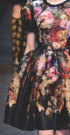 Dolce & Gabbana Fall 2012. Gorgeous renaissance type of dress with a splash of colorful flowers. It's like a walking painting!