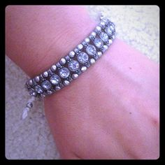 AERO Lavender Rhinestoned Bracelet Lavender stones with silver beads... White adjustable strap. Aeropostale Jewelry Bracelets