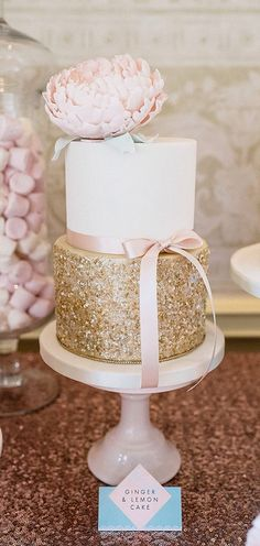 "Gold glitter cake with pretty pink flower. We can help achieve this look at Dallas Foam with cake dummies and cakeboards. Just use ""Pinterest2013"" as the item code and receive 10% off @ www.dallas-foam.com"
