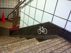 Chicago makes it easy for their cyclists: A small ramp to roll your bike down the stairs to the 'L' trains.