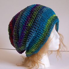 """This pattern began as a nod to writer Malcolm Gladwell. The Outlier Toque is a slouchy style beanie/toque. It is the perfect pattern for a beginner who is making their first hat, and for novices and advanced crocheters looking for a quick, simple project for gifts. I have already decided this is going to be my """"go to"""" hat pattern for the holidays. It looks stunning in self-striping yarn but also looks magnificent in solid colors."""