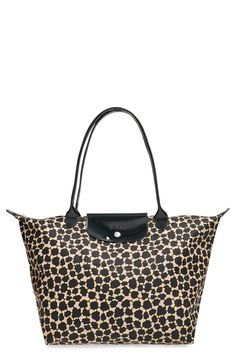 A gorgeous, abstract print reminiscent of cheetah spots covers this sleek nylon tote, perfect for everyday outings or weekend getaways.