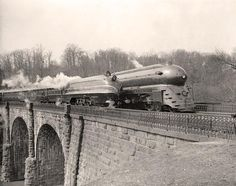 Here for your consideration is an aesthetic picture of Locomotives on bridge. It was created 1938 or 1939 by Harris & Ewing.