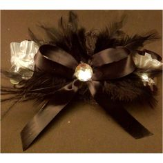 Black and white satin band accented with black satin bow and feathers prom garter!