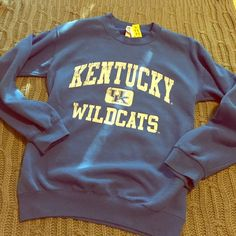 Old school UK Wildcats crew neck sweater Blue crew neck sweater with retro-style worn in UK emblem on the front and plain on the back. Had two small tears in the wrist repaired at an alterations shop, you can't tell they were ever there! Soft and worn in, I love this sweater it's just a tad small for me now. It's a small but could potentially fit a medium as well, it doesn't seem to run small. Sweaters Crew & Scoop Necks