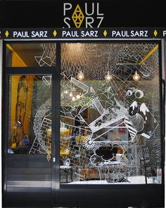 Paul Sarz  Window display design in AthensPhotos by Angelos Ripper  white marker  summer 2013