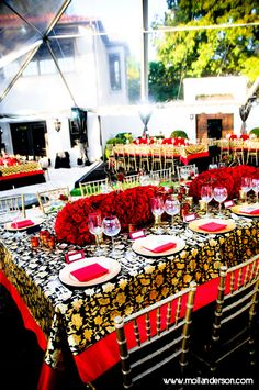 The table cloths were an elegant shimmering gold and black Morrocan pattern layered over a brilliant red. photo by A.K. Vogel