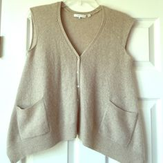 Beige cashmere vest with asymmetrical hem 100% Cashmere wool vest by 360 Cashmere.  The vest is A-Line so the sides fall longer than the front and back making the hem seem asymmetrical. Good condition. No trades. 360 Cashmere Sweaters