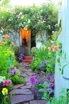 <3Beautiful flagstone garden path!!!!!  Leading to the back where a red door is opened.......thru such a beautiful garden!