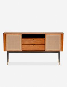 So, so stylish. This functional sideboard is the perfect storage piece for transitional spaces with mid-century leanings, featuring wicker sliding doors, brass accents and two pull-out drawers in a timeless wooden frame. Buffet Cabinet, Sideboard, Dining Room Furniture, Furniture Design, Unique Furniture, Furniture Ideas, Living Room Shop, Machine Made Rugs, Wicker