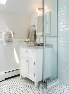 Love the floor tile in this Small Bathroom by Gabym