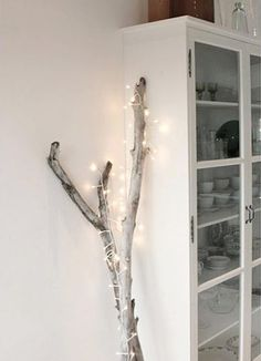 Pretty Christmas Light Displays | House & Home - there are some gorgeous branches for sale in Swiss flower shops, so this would be easy