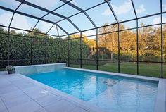 Contemporary Swimming Pool with Skylight, exterior stone floors, Pool Cages, Lap pool, exterior tile floors, Fountain, Fence