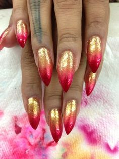 gold with red tipped stiletto nails