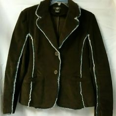 """Choc. Brown Stretchy corduroy blazer Size Lg. Great looking with Jeans or Jean skirt. Stretchy dark brown blazer. Trimmed with frayed denim. Wide lapels, two front buttons. Measures approx. 24"""" in length, sleeves measure approx. 23"""" in length. Bust measures approx. 22"""" from armpit to armpit. Luii Jackets & Coats Blazers"""