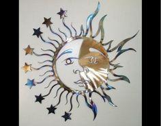 http://www.freewebs.com/hitechart/album%20photos/wall%20art%20500/sun-moon%20with%20stars%20500.jpg