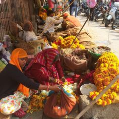"""""""Busy flower sellers on the streets of Jaipur. Love that glorious fragrance as you walk by ....  …"""""""