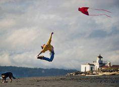 Dancer flying a kite on the beach