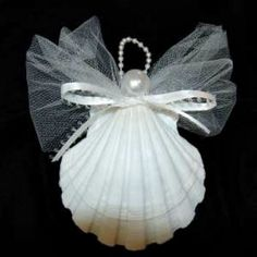 How to Make Seashell Christmas Ornaments.  Tulle netting, satin ribbon and faux pearl & faux pearl string