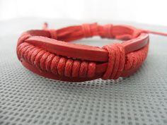 Adjustable red leather Cotton Rope Woven Bracelets  by sevenvsxiao, $3.00