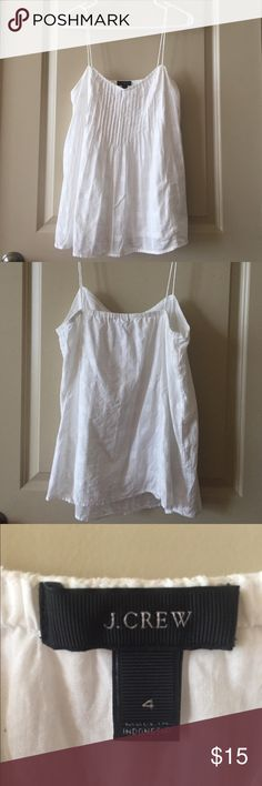 J. Crew White Pintuck Top White J. Crew tank top. Thin straps with pintuck detail. Subtle plaid detail on fabric. Gently used. Looks great with colored or denim bottoms! Perfect for spring and summer! J. Crew Tops Tank Tops