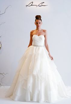 Wow! This Dennis Basso strapless gown features an organza-layered skirt for the perfect princess moment.