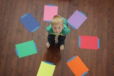 OK, this is so much fun!! Tape different coloured paper on the floor. Then ask child to HUNT for household items/toys/etc and place them on the matching coloured papers! :-D