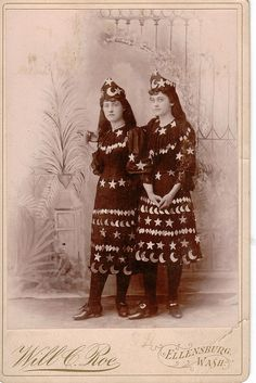 Amazing vintage cabinet card photo of two girls in moon & star costumes.