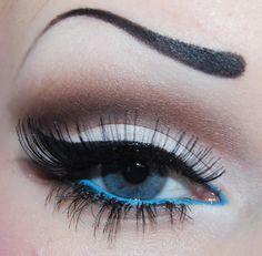 Nice eye makeup! Not digging the fake eyebrow, though...