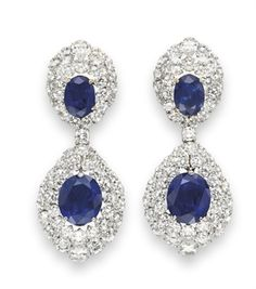 A PAIR OF SAPPHIRE AND DIAMOND EAR PENDANTS, BY HARRY WINSTON  Each suspending a detachable pendant, set with an oval-cut sapphire, weighing approximately 12.45 and 14.61 carats, within a two-tiered graduated circular-cut surround, terminating with a pear-shaped diamond, from a surmount of similar design, set with an oval-cut sapphire, weighing approximately 5.50 and 6.71 carats, mounted in platinum and gold  Signed Winston for Harry Winston