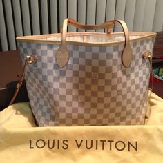 No longer available😜neverfull mm damier azur Pre-owned in an excellent condition authentic Louis Vuitton neverfull Mm in damier azur. Comes with box, dust bag and receipt. This bag has no rips, tears or stains(just regular wear). Almost brand new condition. It was purchase in June, 2013. Please email methsalon at yahoo dot com for more pictures and details. No trade. Thank you. Louis Vuitton Bags