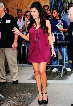 kourtney kardashian in burgundy silky dress with black pumps.