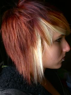 Love the blonde streak, but not so much the red/orange color