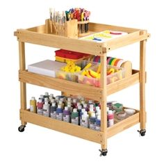 Art supplies stay organized and easily accessible on this hardwood utility cart. Hardwood unit has three easy-to-clean shelves, with two handles and four casters for easy mobility (two locking caster School Furniture, Art Furniture, Creative Writing Workshops, Rolling Utility Cart, Mobile Storage, School Desks, Organize Your Life, Kitchen Cart, Hardwood