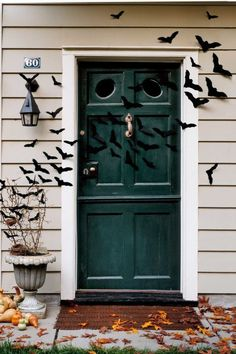 When it comes to outdoor Halloween decorations, why stop at the front door? Extend a cloud of bats across the porch and into the entryway to make an even bigger statement. Click through for the tutorial and more DIY Halloween wreaths.
