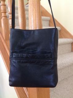 A repurposed thrift store leather coat is now a 9 x 10 handbag with a 20 inch strap drop - to be worn over the shoulder or cross body. A front pocket, inside pockets and a magnetic snap finish the little black bag.
