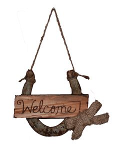 """Charming rustic welcome sign features a reclaimed horseshoe with a hand engraved piece of re-purposed wood. A burlap bow made from old coffee bean bag completes this country welcome! Measures approx 5"""" for the horseshoe on a 5"""" piece of twine . Horseshoes may vary a bit in size, texture and shape."""
