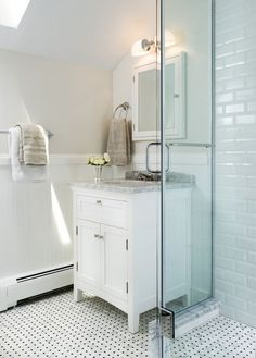 Classic, affordable and widely available, this tile combination can veer modern, traditional or eclectic on a bathroom floor