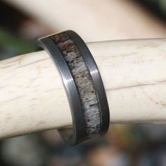 Beautiful Gun Metal Grey Deer Antler Ring with a Sandblasted finish, giving the ring a grainy feel, and a more dull look, which many Men love. Size 14.5 and 15