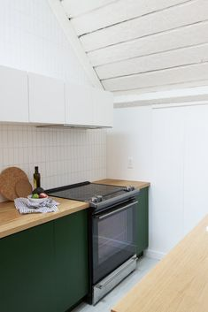 Photo 6 of 14 in A Chic, Renovated A-Frame in Palm Springs Asks $535K - Dwell A Frame Cabin, A Frame House, Wood Cabinets, Kitchen Cabinets, Decoracion Vintage Chic, Fireclay Tile, Sleeping Loft, Wood Counter, Wall Oven