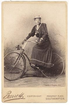 Woman in sailor dress on a bicycle. Note: studio set-up, not actually riding, but cycling was so popular this was a frequent studio set-up.
