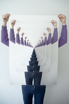 Designer Marco Ugolini demonstrates the proper way to hold a poster within a poster within a poster etc.