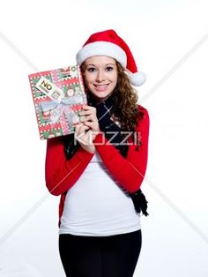 smiling young female with her christmas gift. - Smiling young female with her Christmas gift looking at camera, Model: Brittany Beaudoin