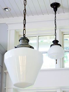 Along With The Reclaimed Wood Flooring, These Antique Schoolhouse Lights  Provide The Kitchen With